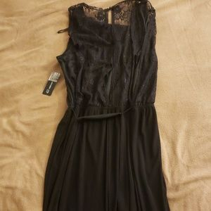 Long dress with lace inlets.